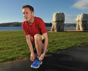 Max Bania (28) is training for the Dunedin Marathon in September and will raise funds for cancer...