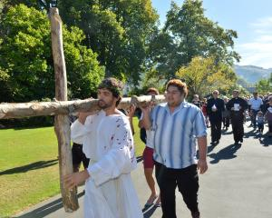 Max Whitaker leads the North Dunedin Walk of the Cross through the Dunedin Botanic Garden...