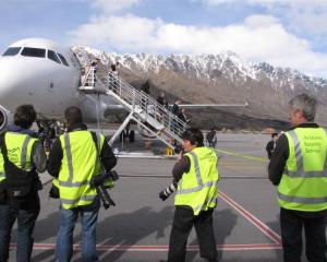 Media wait at Queenstown Airport for the Ireland Rugby World Cup squad to disembark from their...