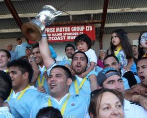 Members of the East Coast rugby team celebrate after winning the Meads Cup final between East...