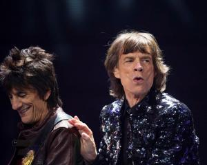 Mick Jagger (R) and Ronnie Wood of The Rolling Stones perform at the Barclays Center in New York...