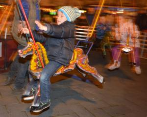 George Ripley (6), of Opoho, rides the merry-go-round.