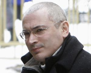 Mikhail Khodorkovsky arrives at a court building in Moscow in this March 2009 file photo. REUTERS...