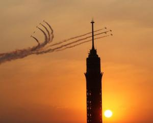 Military jets fly in formation over Cairo as the head of Egypt's constitution court Adli Mansour...