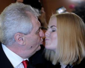 Milos Zeman kisses his daughter Katerina after winning the country's direct presidential election...