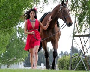 Miss Universe New Zealand second runner-up Deborah Lambie (22), of Dunedin, walks 4-year-old...