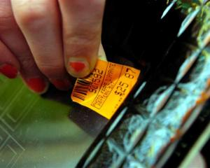 Mitre 10 Mega sales assistant Kelsey Obbeek has spent days replacing price stickers ready for the...