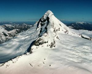 Mt Aspiring's northwest (left) and southwest ridges. A Singaporean climber yesterday fell from...