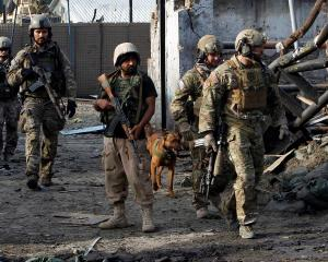 NATO and Afghan troops arrive at the site of a suicide attack in Jalalabad, Afghanistan yesterday...