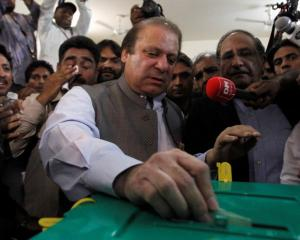 Nawaz Sharif, leader of the Pakistan Muslim League - Nawaz (PML-N) political party, casts his...