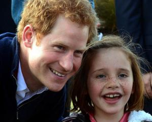 Neave Cameron (7), of Queenstown gets Prince Harry to pose for a photograph at the Stewart Island...