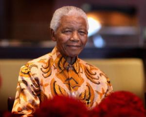 Nelson Mandela attends a lunch to benefit the Mandela Children's Foundation in Cape Town in this...
