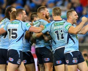 New South Wales players celebrate Josh Dugan's try against Queensland. Photo Getty