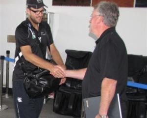 New Zealand captain Daniel Vettori  is greeted by Queenstown liaison manager Ian Paterson as the...