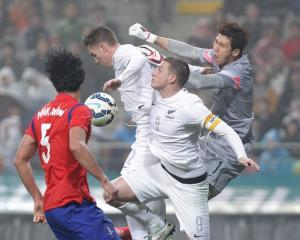 New Zealand's Chris Wood tries to outjump the South Korean defence. Photo by Getty