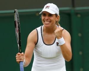 New Zealand's Marina Erakovic celebrates beating Peng Shuai of China in their women's singles...