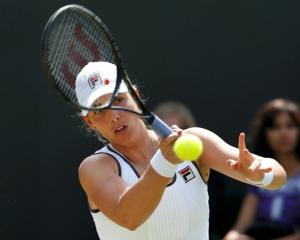 New Zealand's Marina Erakovic hits a return to Britain's Laura Robson during their women's...