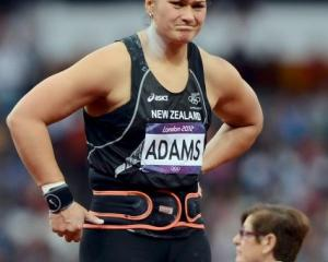 New Zealand's Valerie Adams reacts to winning silver in the women's shot put final at the Olympic...