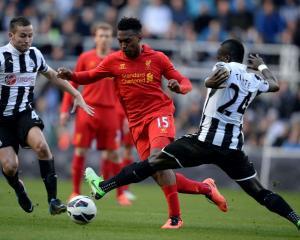 Newcastle United's Yohan Cabaye (L) and Chieck Tiote challenge Liverpool's Daniel Sturridge...