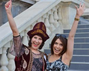 Newly-sworn New Zealand citizen Alevtina Redden (30), left, of Kazakstan, with friend Genia...
