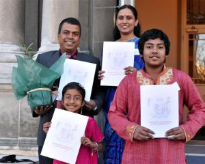 Newly sworn New Zealand citizens Abdul Mannan and Momtaj Begum, with their children, Mridula...