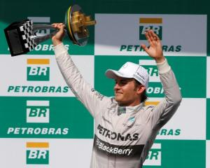 Nico Rosberg celebrates his win in the Brazilian Grand Prix in Sao Paulo. REUTERS/Paulo Whitaker
