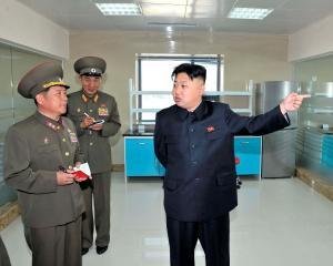 North Korean leader Kim Jong-un (R) visits the Turf Institute of the Bioengineering Branch under...