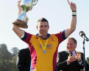 North Otago captain Luke Herden holds the Meads Cup aloft after his team beat Wanganui in the...