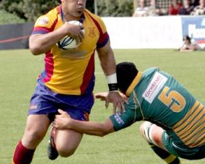 North Otago No 8 Tevita Fifita charges past Mid Canterbury lock Dan Dwyer during the Meads Cup...