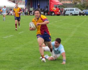 North Otago right wing Whiria Meltzer on his way to the line against East Coast during Saturday's...
