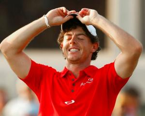 Northern Irish golfer Rory McIlroy reacts on the 18th green after winning the PGA Championship at...