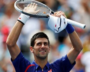 Novak Djokovic of Serbia celebrates after defeating Julien Benneteau of France at the US Open in...