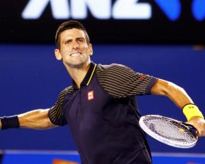 Novak Djokovic of Serbia celebrates defeating David Ferrer of Spain in their men's singles semi...