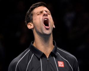 Novak Djokovic reacts after breaking Rafael Nadal's serve. REUTERS/Toby Melville