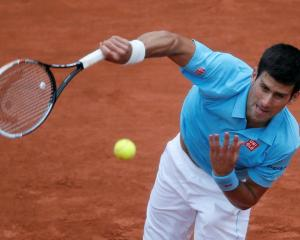 Novak Djokovic serves to Joao Sousa. REUTERS/Gonzalo Fuentes