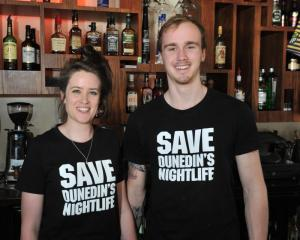 Octagon bar Ratbags staff Laura Dowling (22) and Jared Hewitt (20) wear ''Save Dunedin's...