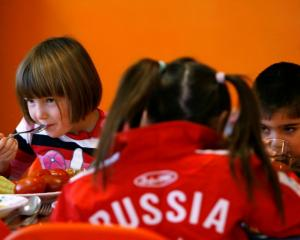 Orphan children have a meal at an orphanage in the southern Russian city of Rostov-on-Don....