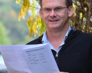 Otago Adventure Development counsellor Scott Blair holds a leaflet on the health effects of...