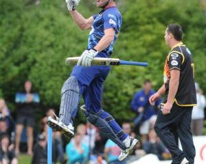 Otago all-rounder Ian Butler leaps into the air after hitting the winning runs.