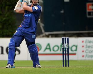 Otago batsman Michael Bracewell plays through the offside during his inninngs of 60 runs off 49...