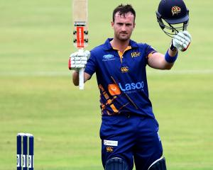 Otago batsman Neil Broom celebrates his century during his side's Ford Trophy preliminary...