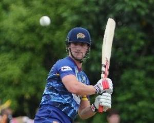 Otago batsman Neil Broom cracks a shot into the off-side during the final of the HRV Cup against...