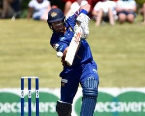 Otago batsman Neil Broom plays through the offside on his way to his century. Photo by Gregor...