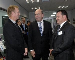 Otago Chamber of Commerce president Peter McIntyre (left) shares a chuckle with Economic...