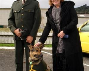 Otago Corrections Facility dog handler Werner Botha and Corrections Minister Judith Collins with...