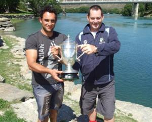 Otago Country captain Brendan Domigan (left) and coach Andy Sainsbury proudly hold the Hawke Cup...