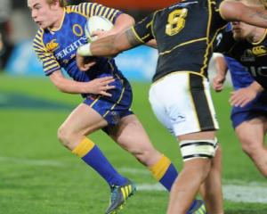 Otago first five Hayden Parker sets off upfield against Wellington during their ITM Cup match at...