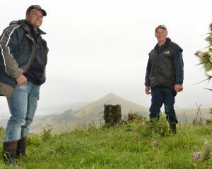 Otago Peninsula Biodiversity Group chairman Brendon Cross (left) and trustee Bob Morris whose...