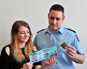 Otago Polytechnic third-year nursing student Katie Officer (21) and Senior Sergeant Chris...