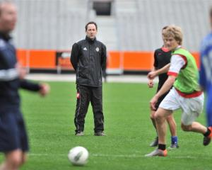 Otago United coach Richard Murray leads his team in training at Forsyth Barr Stadium. Photo by...
